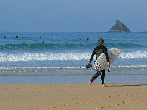 Surfer at Constantine Bay in Cornwall